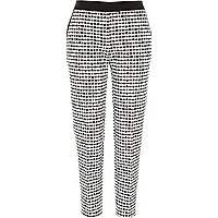 Black and white jacquard cigarette trousers