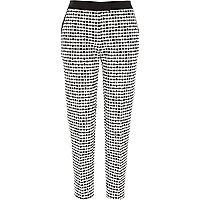 Black and white jacquard cigarette trousers