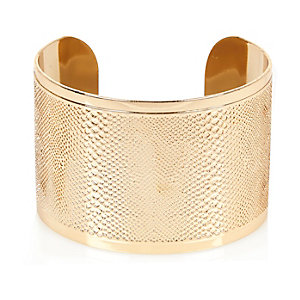 Gold tone snake etched cuff bracelet