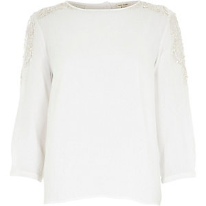 White crepe embellished shoulder top