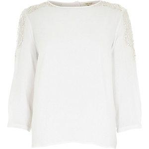 White crepe embellished shoulder top