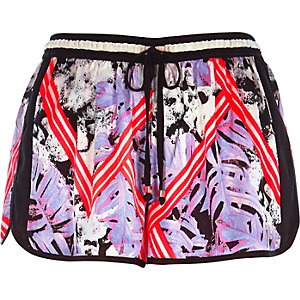 Purple tropical print runner shorts