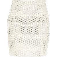 White leather-look laser cut mini skirt