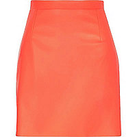 Bright coral raw hem leather-look skirt
