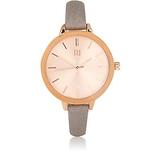 Grey rose gold round watch