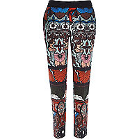 Red paisley print cigarette trousers