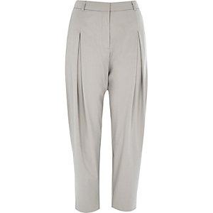 Light grey peg leg trousers