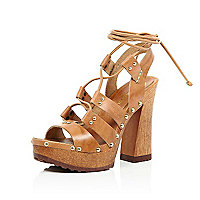 Light brown leather lace up wooden platforms