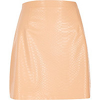 Peach leather-look mock croc mini skirt