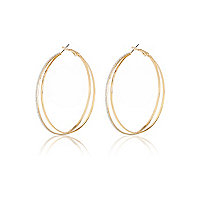 Gold tone glittery double hoop earrings