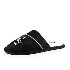 Black monogrammed slippers