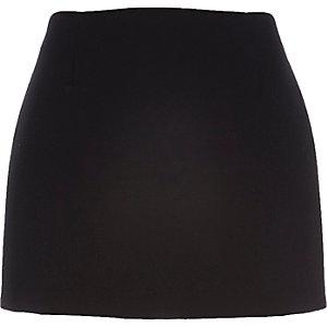 Black pelmet mini skirt
