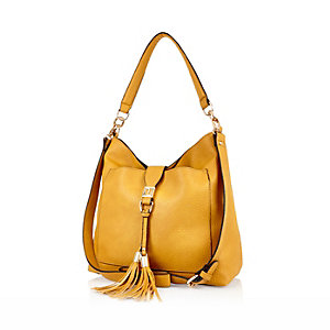 Dark yellow tassel front slouchy bag