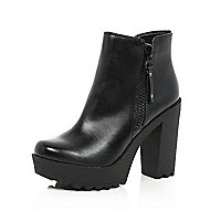 Black cleated sole ankle boots