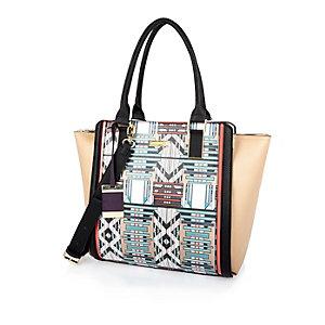 Purple geometric print winged tote handbag