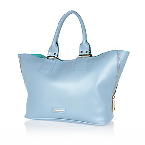Blue unlined zip side tote handbag