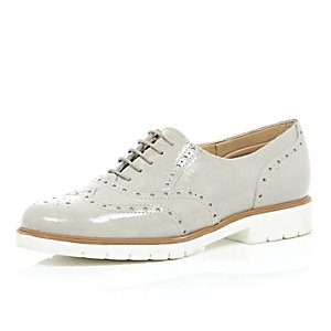 Grey patent leather brogues