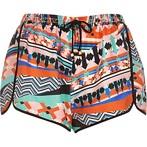 Orange geo print runner shorts
