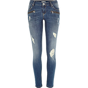 Mid wash zip ripped Cara superskinny jeans