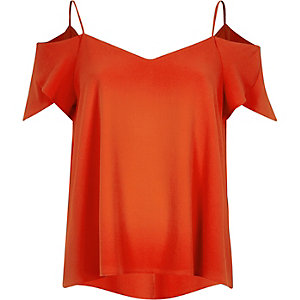 Bright red cold shoulder frilly sleeve top