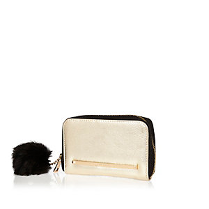 Metallic gold pom pom zip around purse