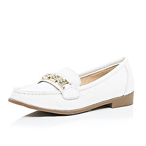 White slip on gold trim loafers