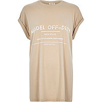 Beige model off duty print oversized t-shirt