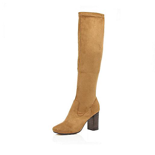 Light brown knee high heeled boots