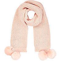Light pink knitted pom pom scarf