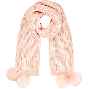 Light pink knitted pom pom scarf