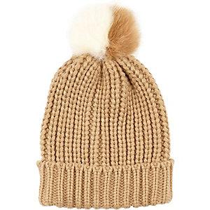 Beige knitted pom pom beanie hat