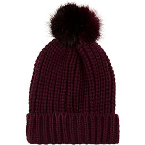 Dark red knitted pom pom beanie hat