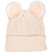 Light pink knitted pom pom hat