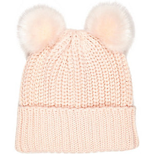 Light pink knitted pom pom hat