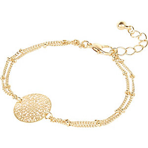 Gold tone filigree coin bracelet