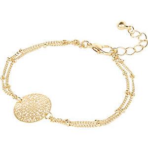 Gold tone filigree coin bracelet