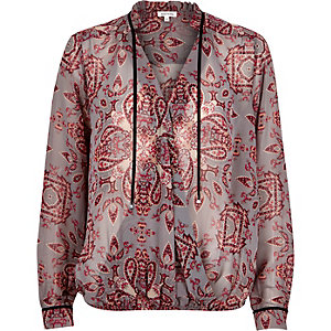 Red print wrap front blouse