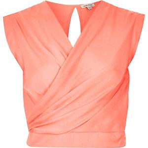 Coral sleeveless wrap crop top