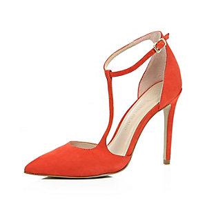 Orange suede asymmetric court heels