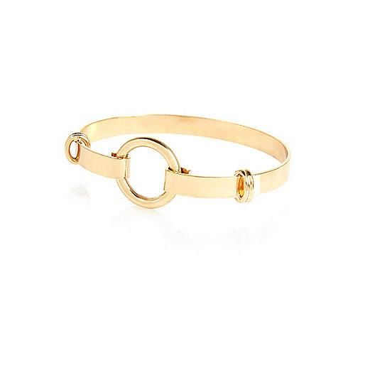Bracelet manchette doré motif cercles design minimaliste