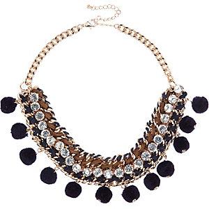 Gold tone pom pom statement necklace