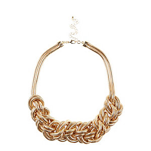 Gold tone slinky knotted necklace
