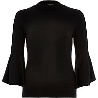 Black fluted sleeve turtle neck top