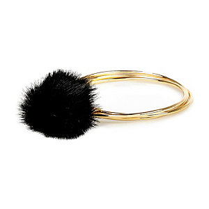 Gold tone pom pom bracelet
