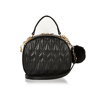 Black quilted pom pom circle handbag