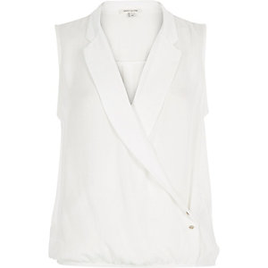 Cream wrap front sleeveless blouse