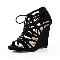 Black lace-up caged wedge heels