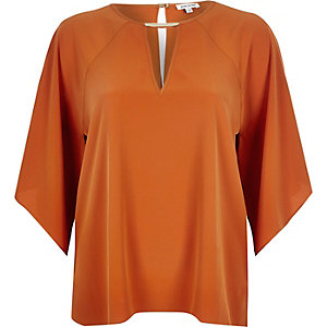 Bright orange cut out t-shirt
