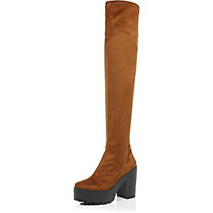 Light brown cleated over the knee boots