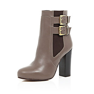 Beige leather buckle heeled ankle boots